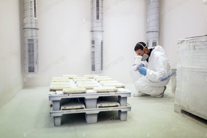Painter using airbrush to paint
