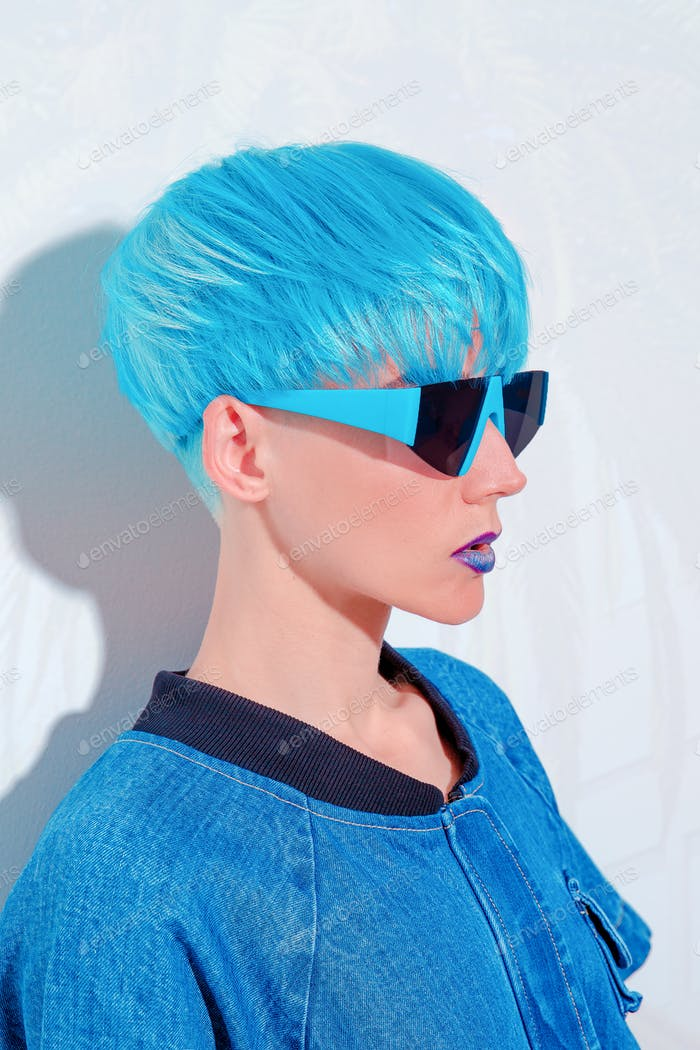 Fashion Model with blue short hair. Trendy colours hair style