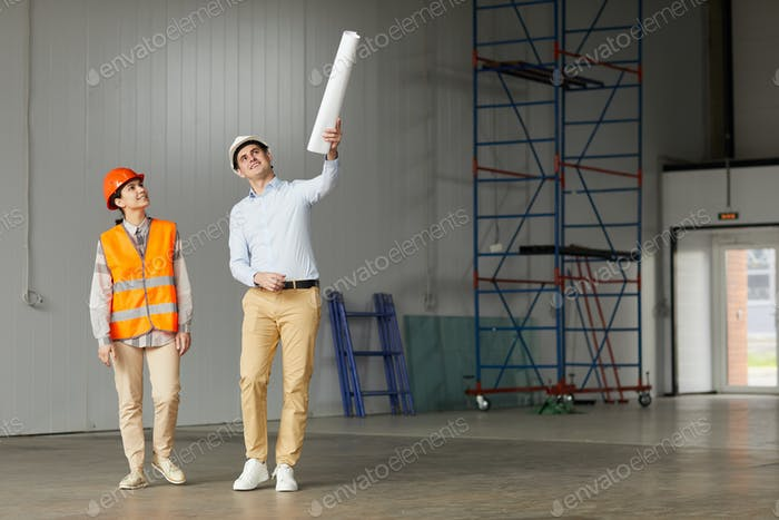 Two engineers on construction site