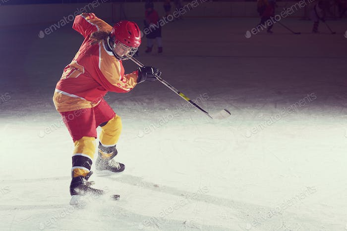 teen ice hockey player in action