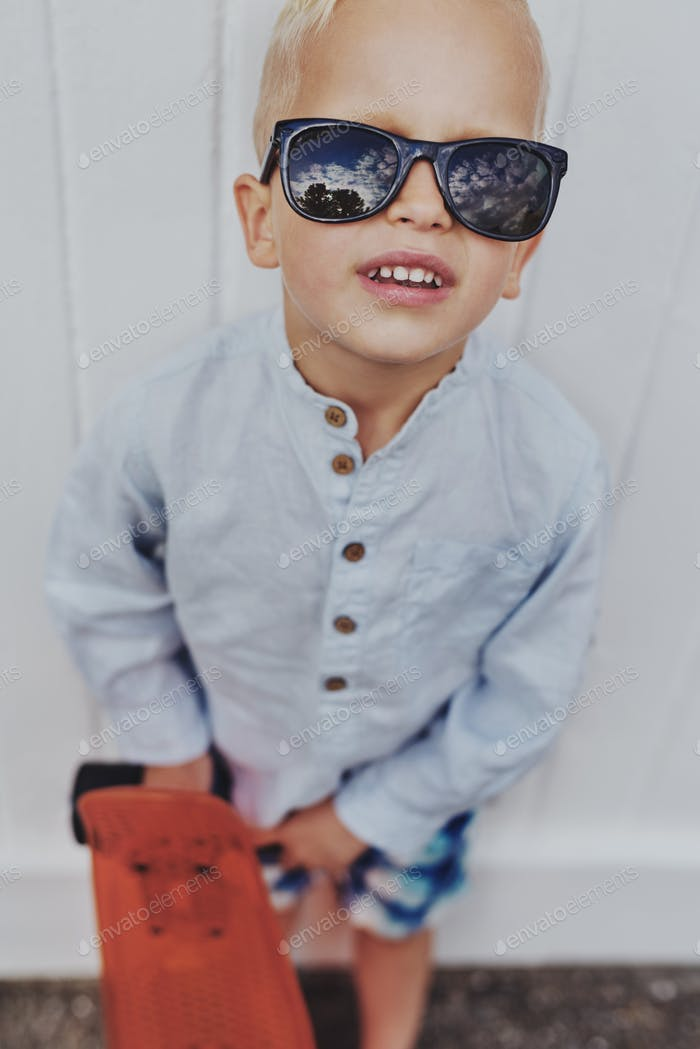 Fun little boy in trendy sunglasses
