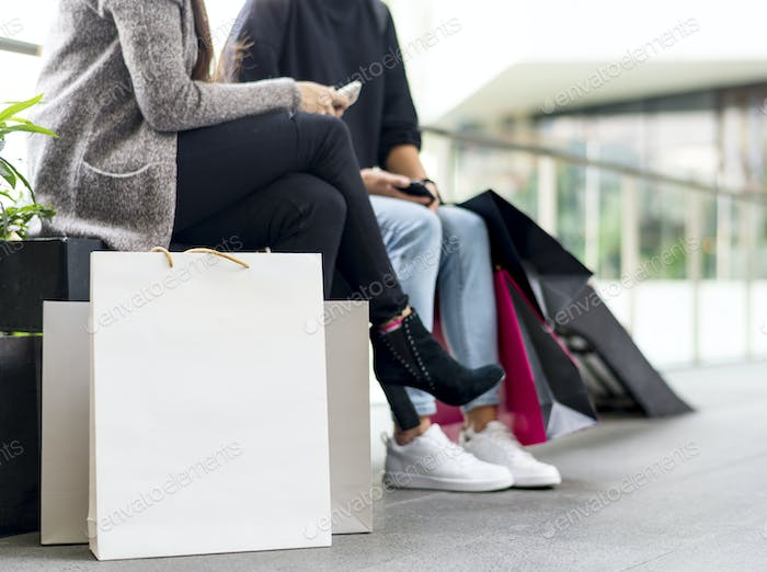 Women taking a break while shopping