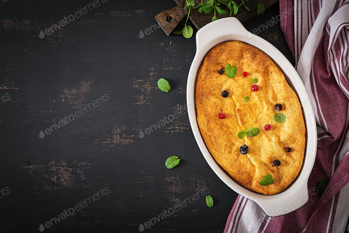 Breakfast. Appetizing cottage cheese casserole on dark table. Top view