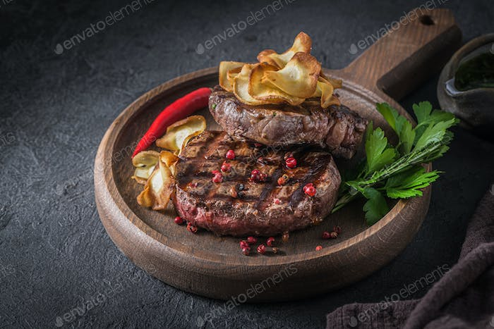 Two fillet mignon steaks with crispy parsnip