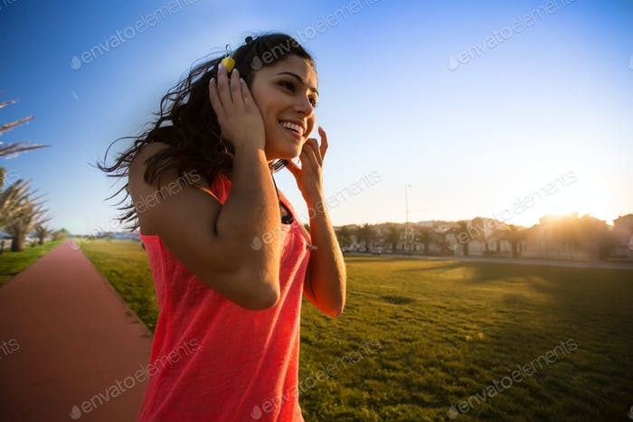 Woman walking and listening music