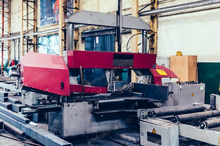 Saw machine for cutting steel profiles in a factory,