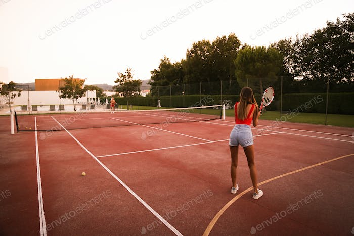 Couple playing tennis at the court