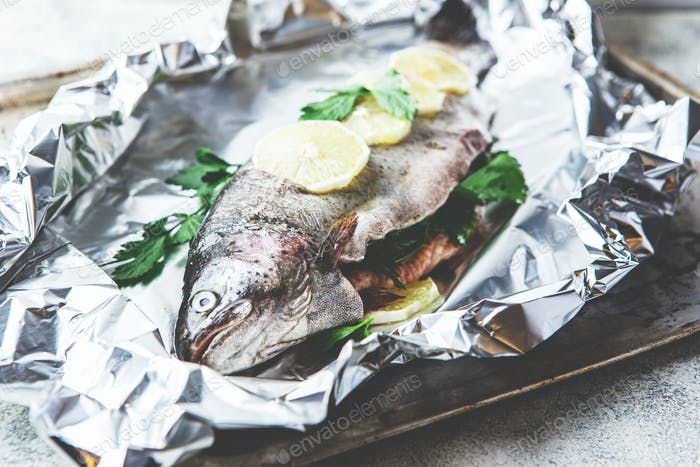 Raw rainbow trout in foil