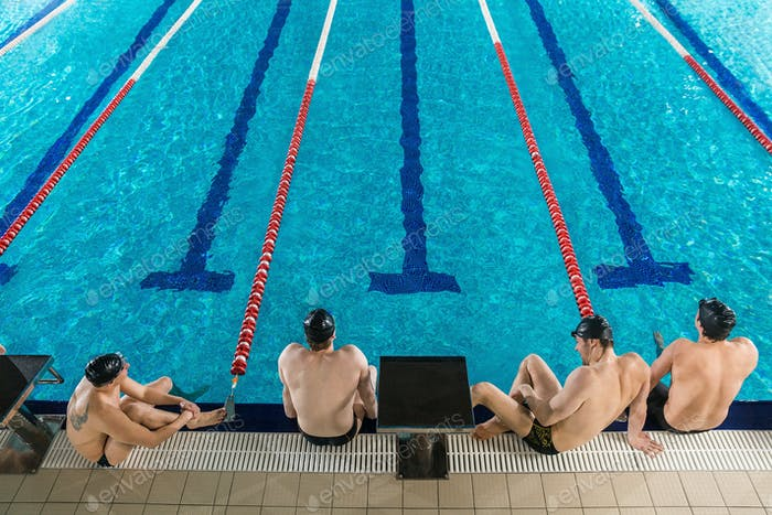 Top view of four male swimmers