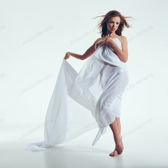 Female model in transparent white cloth