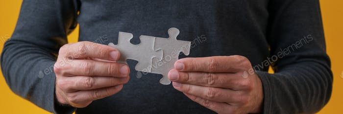 Joining two matching puzzle pieces
