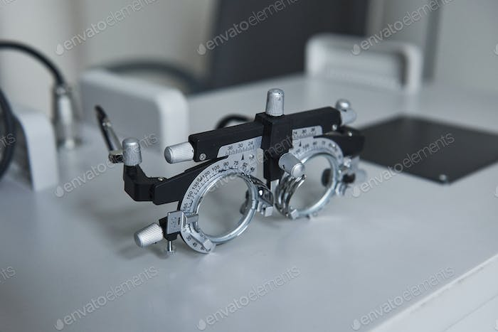 Ophthalmic glasses laying on the white table in the clinic