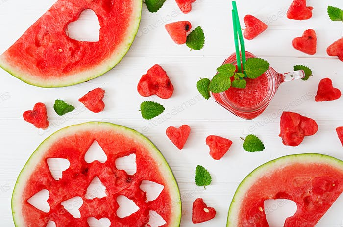Fresh watermelon smoothies with mint on white wooden background. Flat lay. Top view