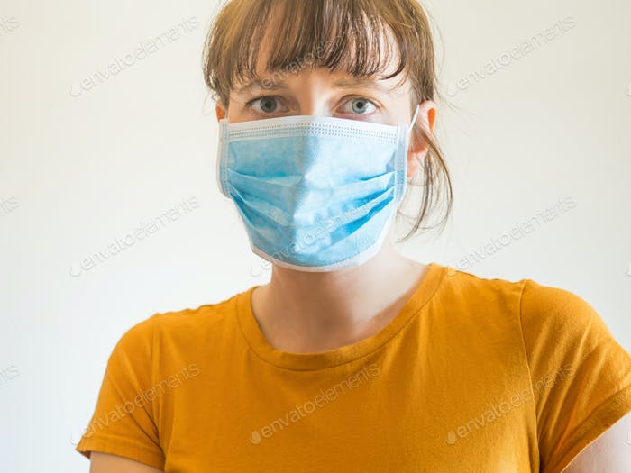 Young woman wearing protective face mask