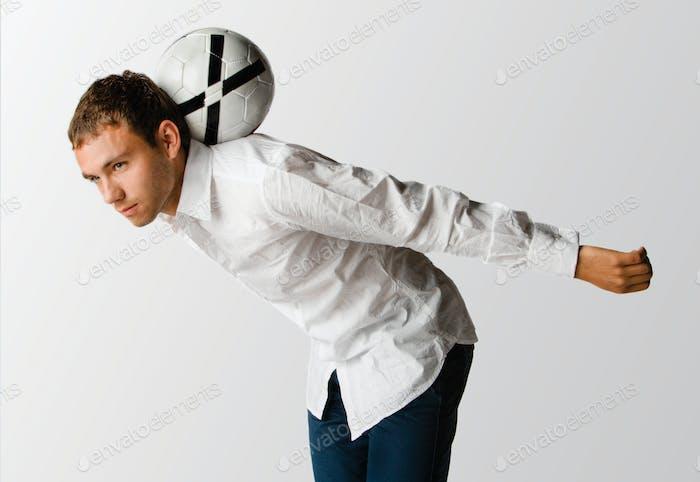 Man balancing football