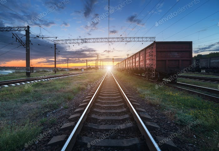 Cargo train platform at sunset. Railroad in Ukraine. Railway sta
