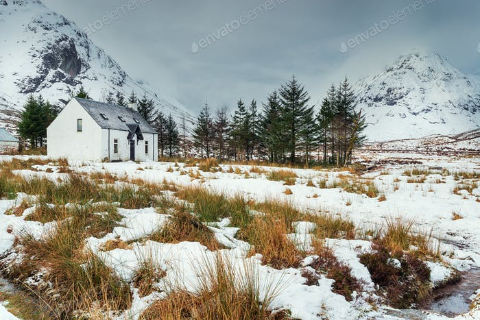 A remote mountain cottage in the snow at Glencoe