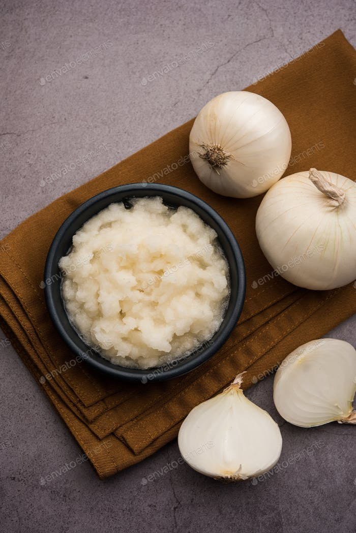 White Onion Puree or Paste in a bowl with raw whole