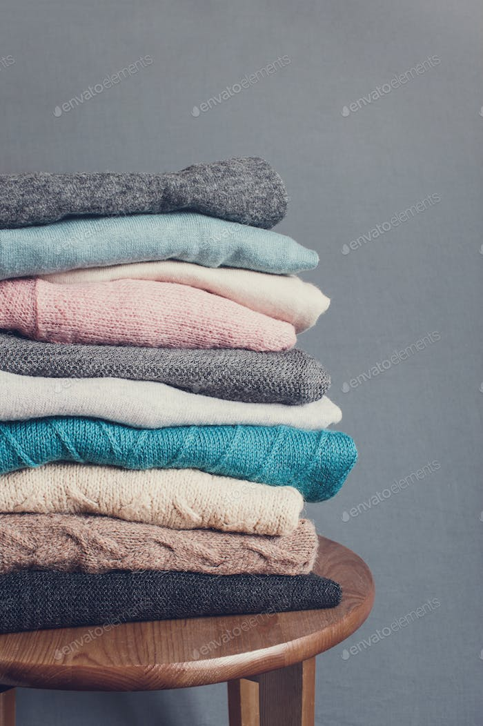Stack of Multicolored Knitted Clothes