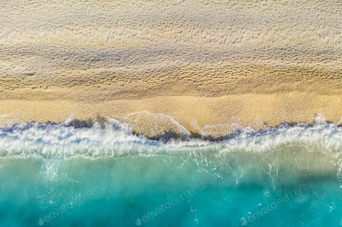 Ocean waves at sunset. Tropical island, Aerial view.
