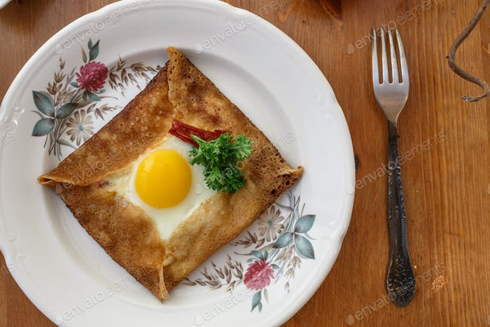 Galette sarrasin, buckwheat crepe, with ham cheese and egg, french brittany cuisine