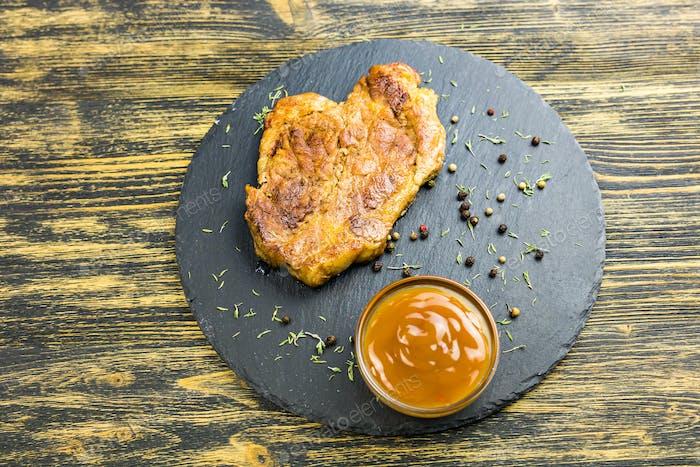 Grilled pork steak with sauce