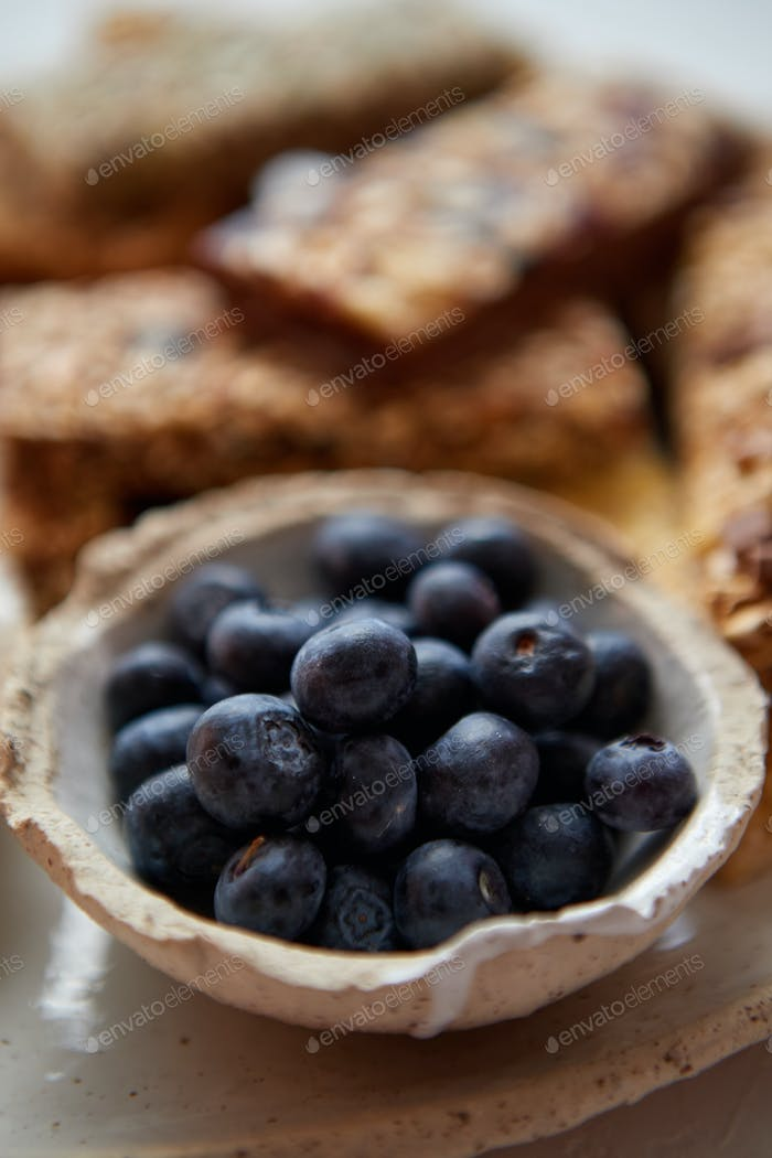 Close up of blackberries. With various energy nutrition bars in background