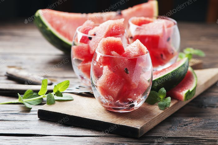 Sweet red watermelon and mint on the wooden table