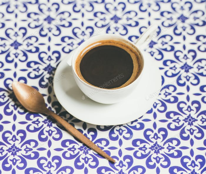 Cup of black Turkish or Eastern style coffee, oriental background