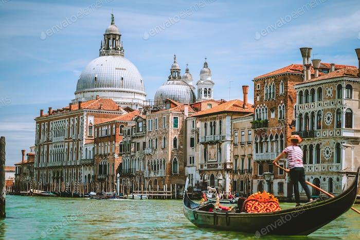 Grand Canal, Traditional Gondola and Basilica Santa Maria della Salute in background, Venice, Italy