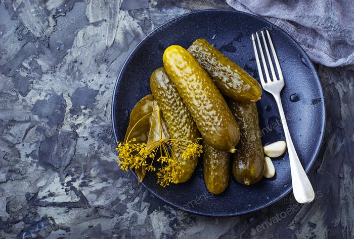 Pickled cucumbers in black plate