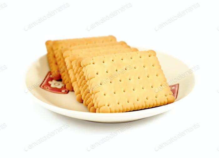 Heap of square crackers in plate on a white background