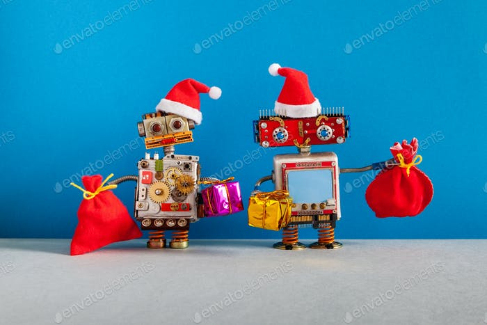Two happy Santa Claus robots with a bags of gifts.