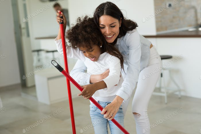 Happy mother with her child cleaning house
