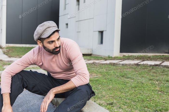 Young Indian man posing in an urban context