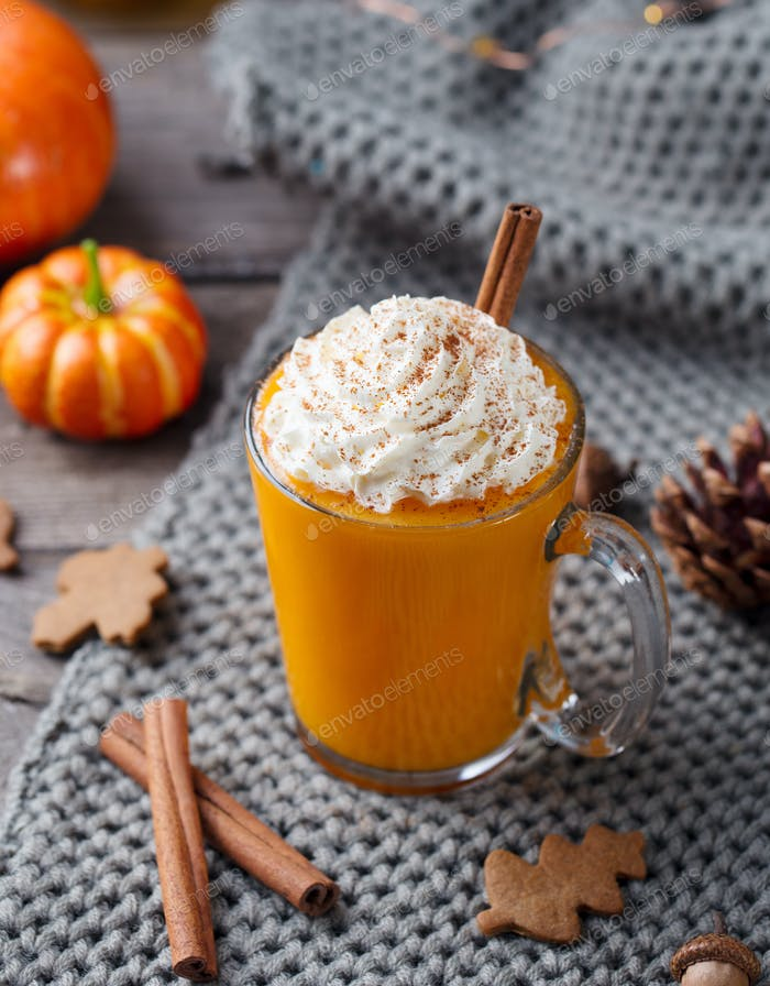 Pumpkin Latte with Spices. Boozy Cocktail with Whipped Cream.