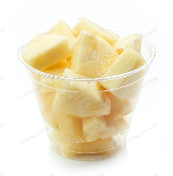 fresh pineapple pieces salad in plastic cup