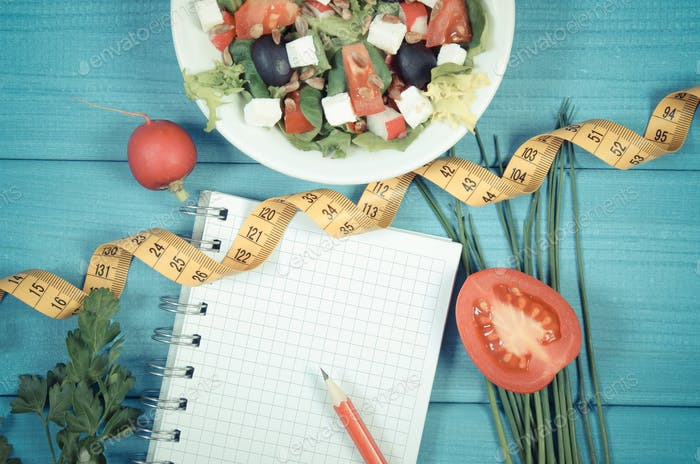 Vintage photo, Greek salad with vegetables, centimeter and notepad for notes