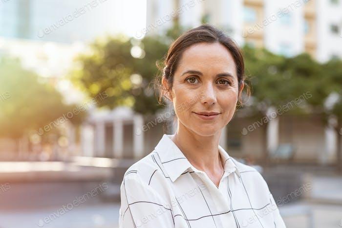 Successful mature woman looking at camera