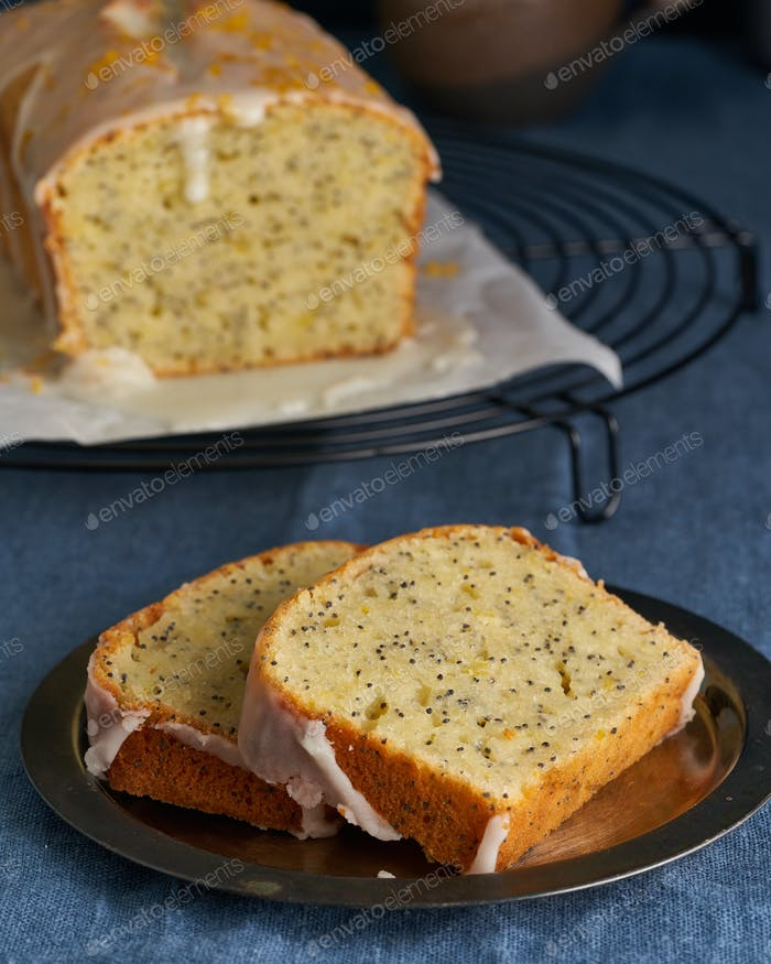 Lemon bread coated with sugar sweet icing and sprinkled with lemon peel