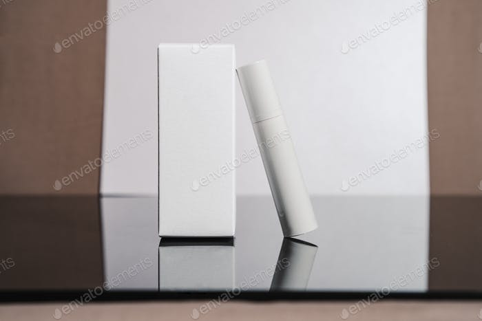 White cosmetic tube and box minimalist beauty still life