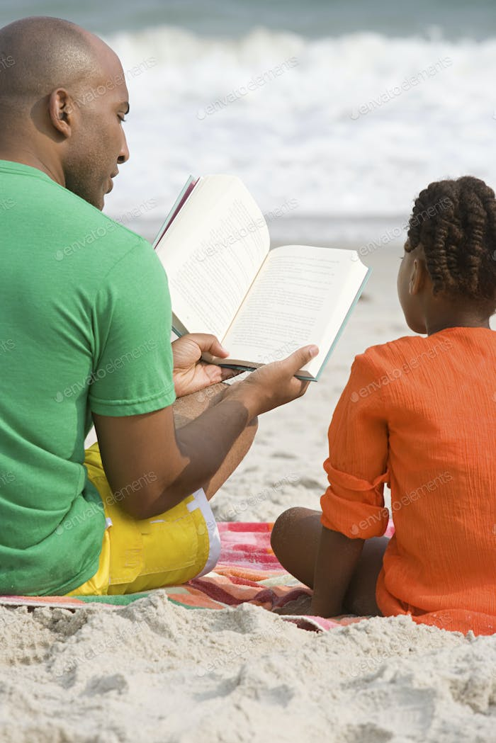Father and daughter reading a book