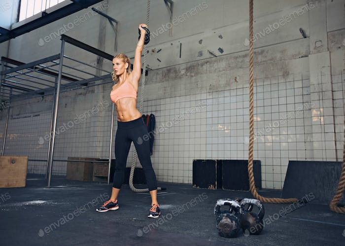 Female athlete in a crossfit workout