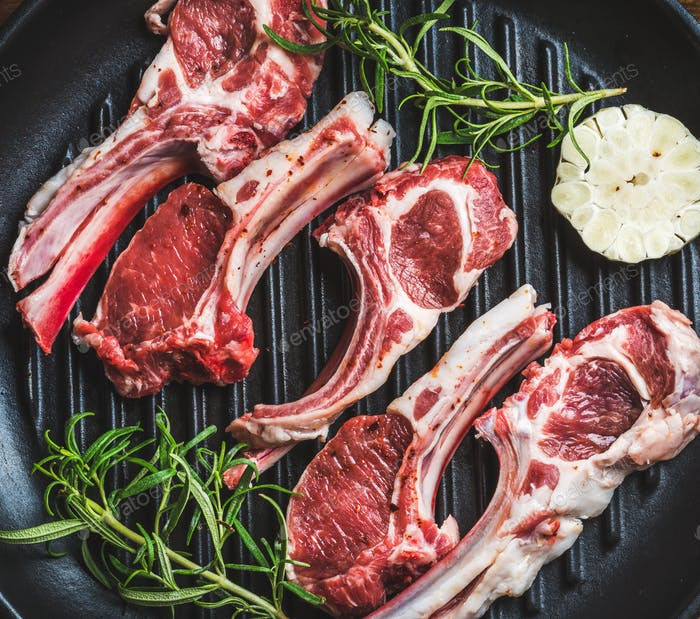 Raw uncooked lamb meat chops with rosemary and garlic