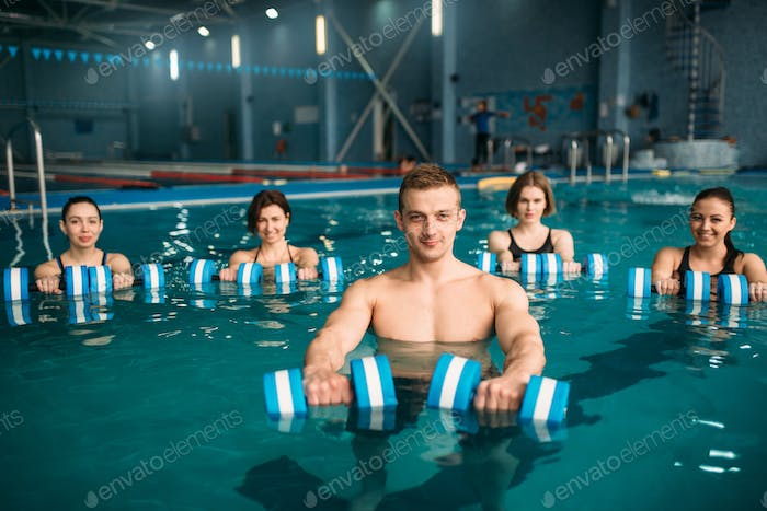 Aqua aerobics group, exercise with dumbbells
