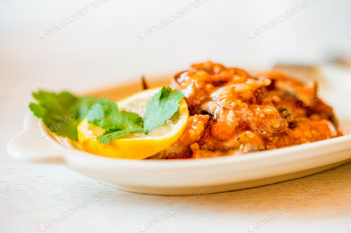 Homemade fish stew with tomato filling on the plate