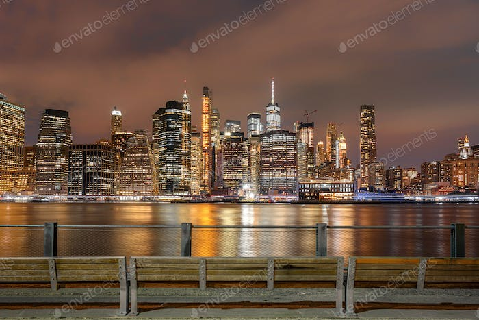 New York Cityscape beside the east river at the night time, USA downtown, Architecture and building