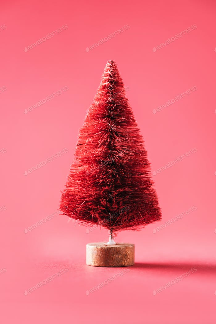 Zero waste Christmas tree on red background. Minimal concept. Copy space for your design
