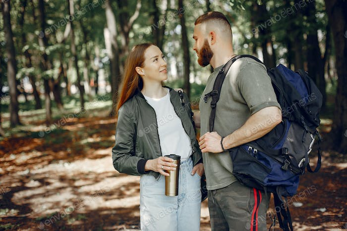 Cute couple have a rest in a summer forest