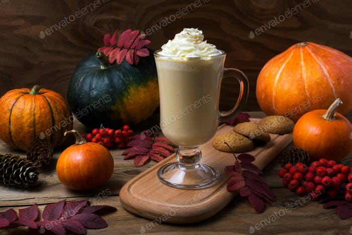 Pumpkin spice coffee latte with whipped cream